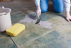 tile grout repair. A Man Repairing The Grout On Tile Floor Repair D