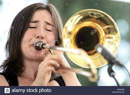 St. Helena, CA, USA. 1st June, 2018. Trombonist Sophie Powers plays with KJ  All-Stars at the 2018 Barrel Auction of Auction Napa Valley at Charles Krug  Winery in St. Helena on Friday.