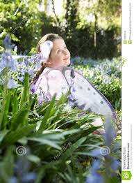 girl in fairy costume at flower garden