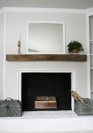 again love the reclaimed look to the wood even with being stained also wood fireplace mantelreclaimed wood mantlewhite brick