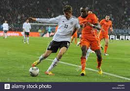 Germany's Thomas Müller and Dutch Edson Braafheid (R) fight for the Stock  Photo - Alamy