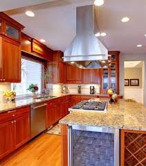 built in stove. This Lengthy Traditionally Styled Kitchen Is Centered On A Massive Island, Featuring Built-in Built In Stove