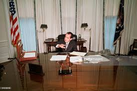 nixon office. president richard nixon gives the press a tour of oval office on his first day