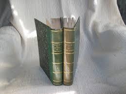 les 2 volumes petit manque de papier en bordure du 1er plat du 1er bel exemplaire malgré es défauts signalés complet des deux volumes de leur texte
