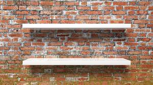 stock photo two empty white wall shelves on red brick wall