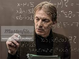 caucasian teacher writing on glass wall stock photo