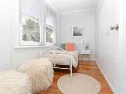 Small Bedroom Renovation Bedroom Modern Renovation Furry Pouf Picture Rail Round Area Rug