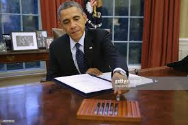 inside the oval office. U.S. President Barack Obama Signs Three Bills Into Law On The Resolute Desk Inside Oval Office
