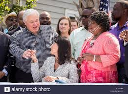 south carolina governor nikki haley gifts a signing pen to north charleston mayor keith summey after signing into law the first bill in the nation requiring