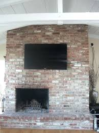 mounting a tv above a fireplace hiding wires led mounted to brick fireplace and wires install