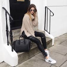 adidas shoes for girls superstar black. an oversize turtleneck sweater, black jeans with zippers, and white sneakers. adidas superstar shoes for girls p