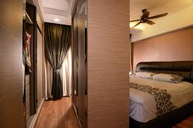 here a galley style closet sits at the foot of the bed traffic is limited and can only be accessible by passing through the wardrobe