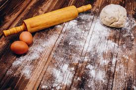 Place On The Wooden Table With Rolling Pin Dough Eggs And Flour