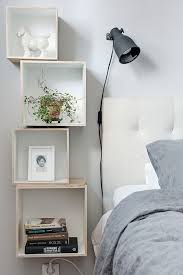 wooden cubbies with white backs instead of a nightstand