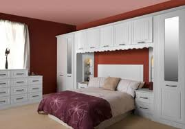 wall furniture for bedroom. feminine bedroom beautiful design red painted wall white fitted furniture for