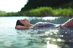 girl floating in water... ...