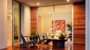 an sliding glass patio door with wood side panels