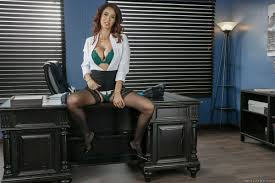Isis Love takes on fat cock at the office in sexy stockings.