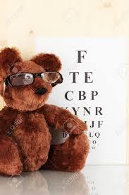 Teddy Bear Chart Teddy Bear With Glasses On Eyesight Test Chart Background Close Up