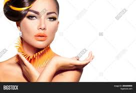 fashion model portrait with yellow and orange makeup creative hairstyle hairdo make
