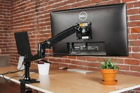 the hefty clamp on the basics is easy to secure onto a desk photo ryan flood the basics single monitor display mounting arm