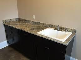 yellow river granite laundry by luxury countertops