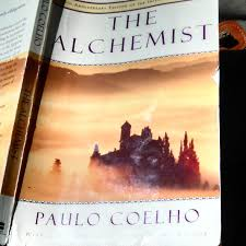 artists riding bitch my tattered copy of the alchemist by paulo coelho