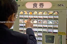 Vending Machine Restaurant Enchanting Man Choosing Meal From Vending Machine At A Noodle Restaurant In