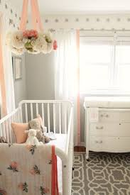 and White: Peach and Gray Nursery Reveal. Love the floral mobile.
