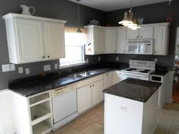 image of dark granite countertops with white kitchen cabinets