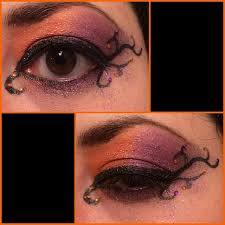 makeup a blend of orange and purple with some black vines growing off cat eye topped