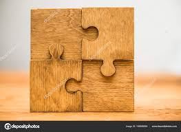 four wooden puzzle pieces concept connection people stock photo