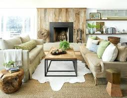farmhouse living room rug natural materials accentuate this room sofas and cowhide and sisal rugs add