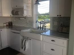 farmhouse style kitchen with white shaker cabinets