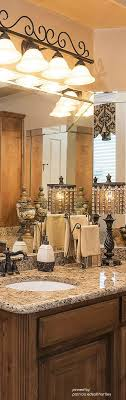 bathroom lighting images. Too Busy 4 Me Like The Light Fixture With Scroll Traditional Master Bathroom Granite Stone Lighting Images