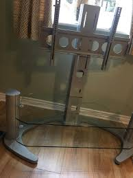 tv stand with tv bracket silver metal and glass shelves