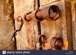 old wooden door with lock system stock image