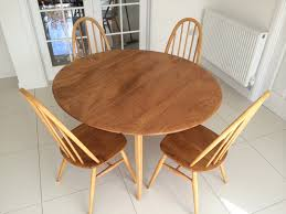 ercol round drop leaf table with quaker chairs
