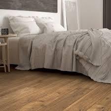 Pictures of laminate flooring Hardwood Flooring Brown Wide Plank Laminate Flooring In Bedroom Homedit Laminate Flooring Accessories