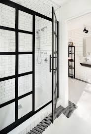 black and white industrial boys bathroom boasts black and white floor tiles framing a walk in shower fitted with a black steel frame shower enclosure