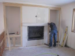 framing in the fireplace built in shelves construction2style on remodelaholic