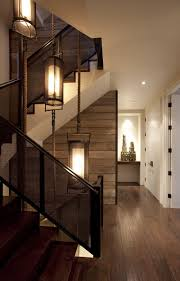 stairwell lighting. this appears to be a home with three levels so clever homeowner has selected fixtures and placed them at different create lighting for stairwell
