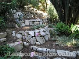 Ideas for building my rock wall in the flower garden