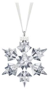 The 2010 Annual Edition Swarovski Christmas Ornament brings an element of  sparkle to the Christmas season. Clean lines that emphasize shimmering  facets of ...