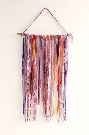 wall hanging made of purple fabric hangings
