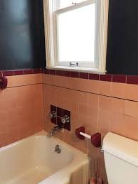 the old bathroom had always been dreary and sad having lost any semblance of 1940 s glamour due to a pummeling of bad repairs and abuses before and during