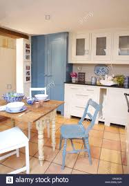 Country Kitchen Floors Blue Painted Chair Beside Old Painted Table In White Country