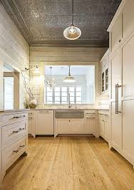 perfectly rustic in this kitchen shiplap with pressed tin ceilings and pine floors creates a perfect place to cook up all your meals