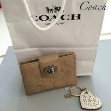 coach handbags red c imprinted patent leather wallet how to clean