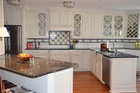 image of white kitchen cabinets with granite countertops and dark floors picture